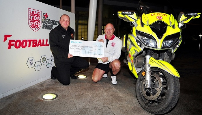 St Georges Park, Andrew Haywood with Phil Sutton from Staffordshire and Shropshire Blood Bikes.